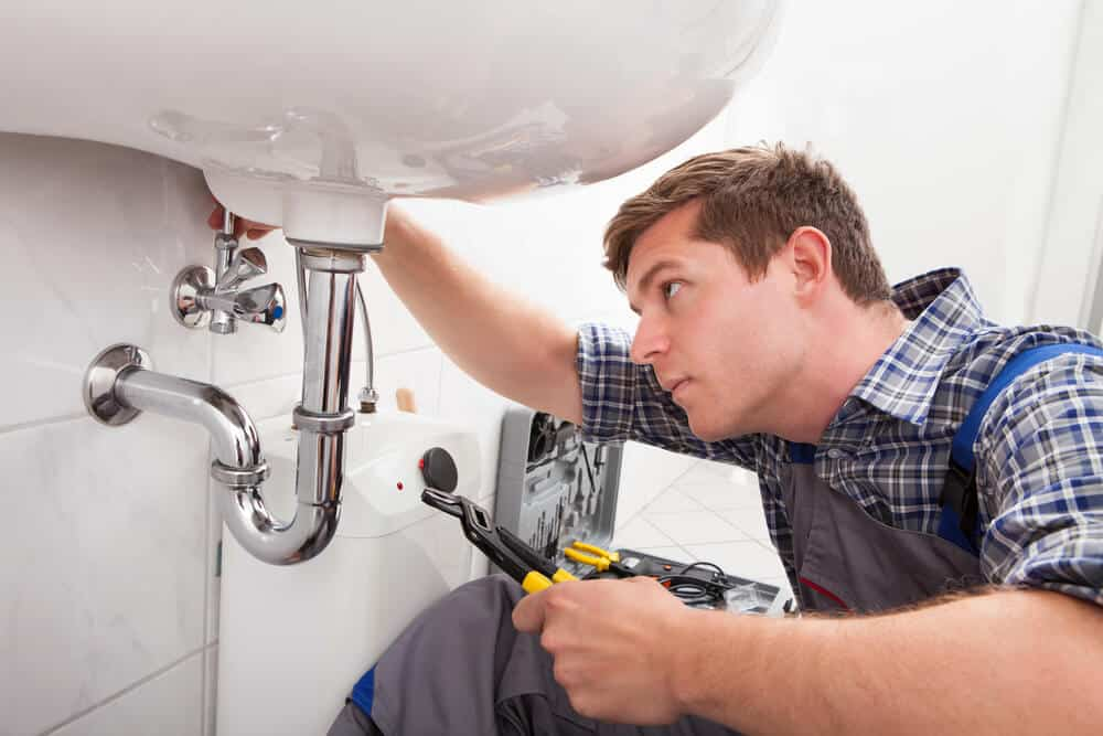 plumber-checking-leaks-under-sink